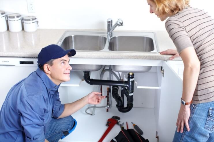 Plumber Talking To Client